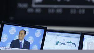 Berlusconi anche sui monitor della Borsa tedesca (Reuters).