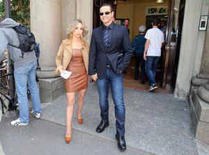 Marina Berlusconi con il marito all'uscita dal seggio elettorale