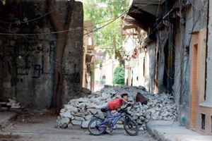 Giochi nelle strade di Aleppo. Prima della guerra i cristiani della città erano 300 mila,  su 2 milioni di abitanti (Reuters).