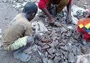 10.223907_Children sorting and crushing cobalt ore in the neighbourhood of Kasulo_ Kolwezi_ DRC