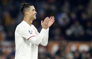 Cristiano Ronaldo nel match con la Roma all'Olimpico (Ansa/Riccardo Antimiiani).