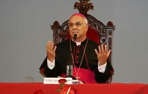 Monsignor Vincenzo Bertolone,  74 anni, arcivescovo di Catanzaro-Squillace. Foto Ansa. In alto e in copertina: la Basilica dell'Immacolata a Catanzaro.